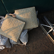 Bases and sand bags stored near the dugout during the New Britain Rock Cats Vs Binghamton Mets Minor League Baseball game at New Britain Stadium, New Britain, Connecticut, USA. 2nd July 2014. Photo Tim Clayton