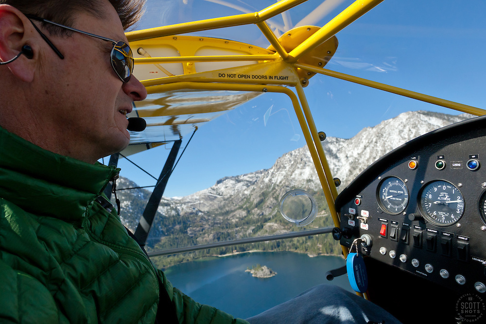 """Pilot over Emerald Bay 2"" - This pilot was photographed flying an amphibious seaplane over Emerald Bay in Lake Tahoe, CA."