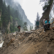 A bus nearly topples off the road below Gangotri. Steep topography and massive rainfall during the monsoon create hundreds of landslides along roads in the Indian Himalaya each year, killing thousands and isolating communities.