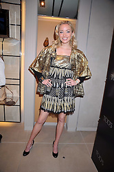 NOELLE RENO at a party hosted by TOD's to celebrate the launch of the J.P.Loafer collection, held at the TOD's Boutique, 2-5 Old Bond Street, London on 31st March 2009.
