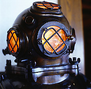 San Francisco, California: Trader Vics Restaurant serves Asian Island-style food in their restaurant designed with original Tiki-inspired decor including this diver's helmet lamp. 2005 (photo: Ann Summa).