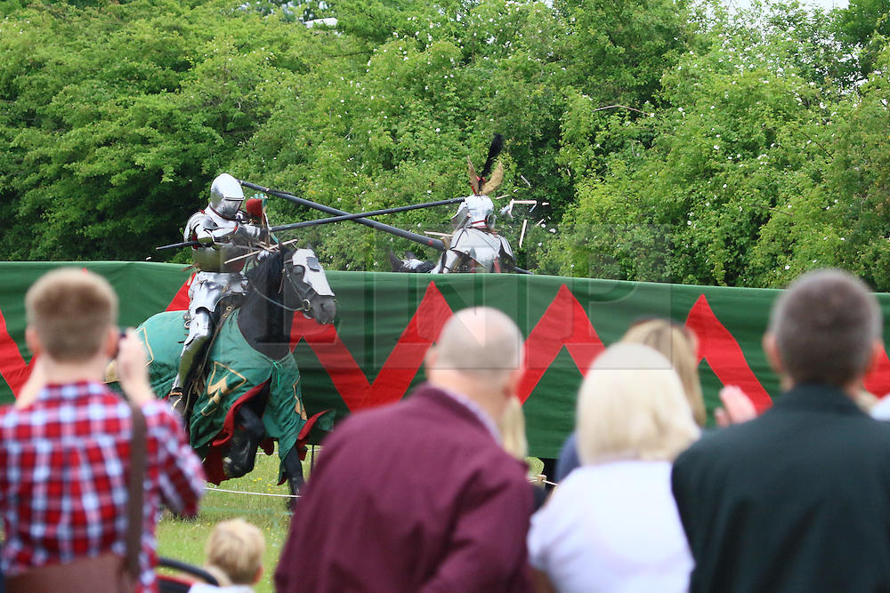© Licensed to London News Pictures. 20/06/2015.  Eltham, London. A corner of London was transported back to medieval times today as two days of jousting, falconry and historic re-enactments got underway. English Heritage's Eltham Palace plays host to the Grand Medieval Joust weekend each summer. The weather for the medieval joust was warm and humid with occasional showers. Credit : Rob Powell/LNP
