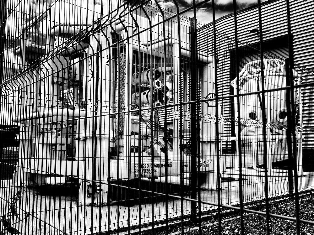 Machinery behind fencing