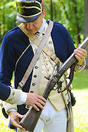 8/18/12 11:46:51 AM - Warwick, PA. -- John Godzieba of Langhorne, Pennsylvania demonstrates the use of a rifle during a revolutionary war reenactment at the Moland House August 18, 2012 in Warwick, Pennsylvania. -- (Photo by William Thomas Cain/Cain Images).