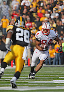 October 23 2010: Wisconsin Badgers tight end Lance Kendricks (84) tries to avoid the defenders during the first half of the NCAA football game between the Wisconsin Badgers and the Iowa Hawkeyes at Kinnick Stadium in Iowa City, Iowa on Saturday October 23, 2010. Wisconsin defeated Iowa 31-30.