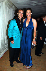 TOM RUTHERFORD and TAMARA VESTEY at the Cowdray Gold Cup Golden Jubilee Ball held at Cowdray Park Polo Club, on 21st July 2006.<br /><br />NON EXCLUSIVE - WORLD RIGHTS