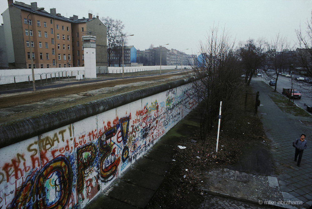 """The Berlin Wall contstructed in 1961 by the German Democratic Republic (GDR, East Germany) completely cut off West Berlin from the surrounding East Germany. The barrier included guard towers a """"death strip"""" and anti vehicle trenches. The Eastern Bloc claimed that the wall was erected to protect its population from fascist elements conspiring to prevent the """"will of the people"""" in building a socialist state in East Germany. The wall fell in November 1989."""