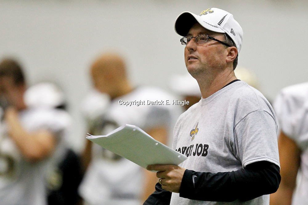 July 26, 2012; Metairie, LA, USA; New Orleans Saints offensive coordinator Pete Carmichael during the first day of of training camp at the team's indoor practice facility. Mandatory Credit: Derick E. Hingle-US PRESSWIRE