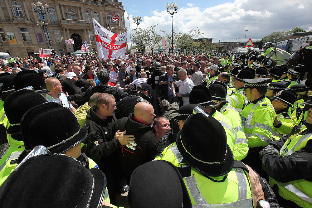 EDL march and hold a rally in Dewsbury, nr Leeds, UK 30/06/2012