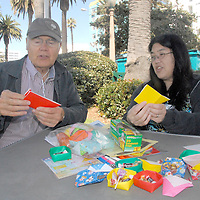 Pat Kuramoto teaches Origami to James Curley during Senior & Family Intergenerational Arts Festival: Celebration of Life on Saturday, October 9, 2010.