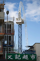 © licensed to London News Pictures. London, UK 28/10/2013. A crane collapsed on a building at Old Kent Road, south London after the St Jude's Day Storm battered the capital with high winds on Monday, 28 October 2013. Photo credit: Tolga Akmen/LNP