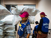 30 AUGUST 2016 - BANGKOK, THAILAND: Volunteers bring food up to distribution center at the end of Hungry Ghost Month in Bangkok. Chinese temples and shrines in the Thai capital host food distribution events during Hungry Ghost Month, during the 7th lunar month, which is usually August in the Gregorian calendar.          PHOTO BY JACK KURTZ