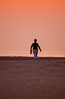 New York, Long Island - walking into the red sunset.