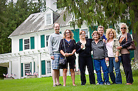 The Dilley family poses for a picture in front of the Clark House on Hayden Lake during a sight seeing trip Sunday, July 4, 2010.