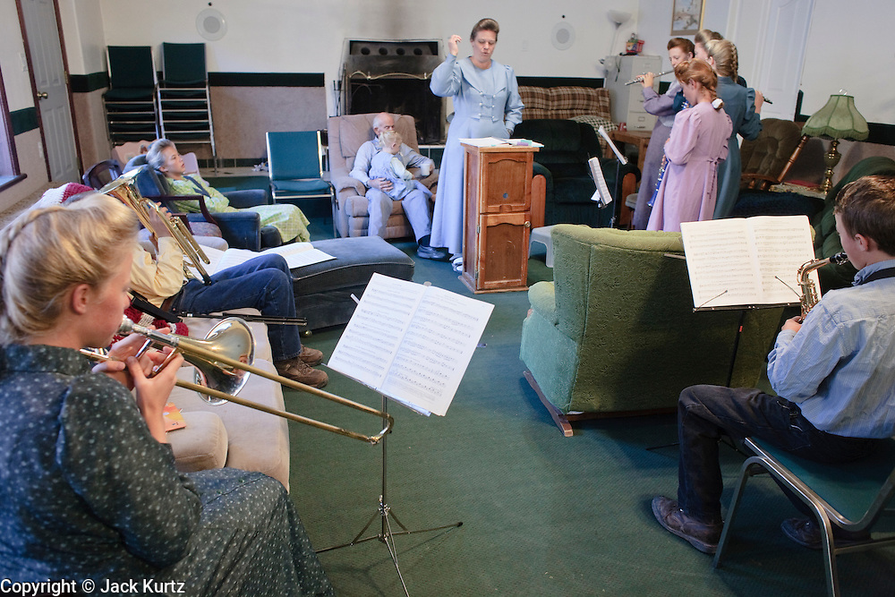 "Sept 8, 2008 -- COLORADO CITY, AZ:  Members of the Jessop family, polygamist members of the FLDS, participate in band practice in their home before starting their day in home schooling. Members of the FLDS pulled their children from the public schools several years ago, now most of the families in town home school their children. The Jessops have almost 40 youngsters, in grades kindergarten through 8th grade, in their home school. Colorado City and the neighboring town of Hildale, UT, are home to the Fundamentalist Church of Jesus Christ of Latter Day Saints (FLDS) which split from the mainstream Church of Jesus Christ of Latter Day Saints (Mormons) after the Mormons banned what they call ""Celestial Marriage"" (polygamy) in 1890 so that Utah could gain statehood into the United States. The FLDS Prophet (leader), Warren Jeffs, has been convicted in Utah of ""rape as an accomplice"" for arranging the marriage of teenage girl to her cousin and is currently on trial for similar, those less serious, charges in Arizona. After Texas child protection authorities raided the Yearning for Zion Ranch, (the FLDS compound in Eldorado, TX) many members of the FLDS community in Colorado City/Hildale fear either Arizona or Utah authorities could raid their homes in the same way. Older members of the community still remember the Short Creek Raid of 1953 when Arizona authorities using National Guard troops, raided the community, arresting the men and placing women and children in ""protective"" custody. After two years in foster care, the women and children returned to their homes. After the raid, the FLDS Church eliminated any connection to the ""Short Creek raid"" by renaming their town Colorado City in Arizona and Hildale in Utah. The Jessops are a polygamous family and members of the FLDS.   Photo by Jack Kurtz / ZUMA Press"