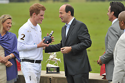 Left to right, HRH PRINCE HARRY and Christian Porta CEO of Chivas Brothers at the Sentebale Polo Cup held at Coworth Park, Berkshire on 12th June 2011.