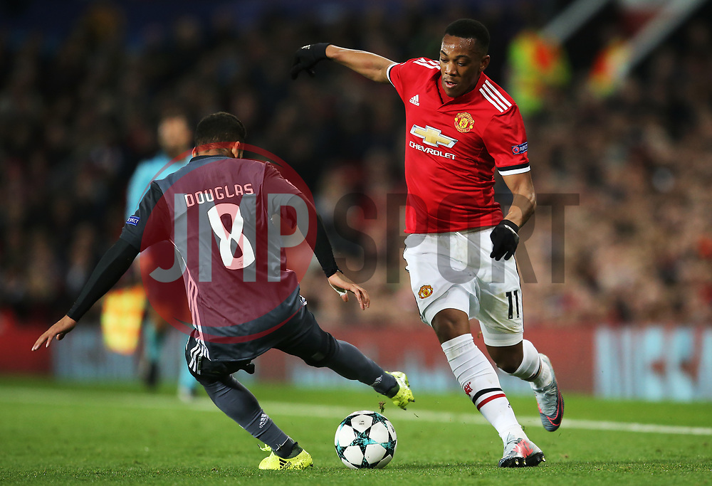 Manchester United's Anthony Martial takes on Douglas of Benfica  - Mandatory by-line: Matt McNulty/JMP - 31/10/2017 - FOOTBALL - Old Trafford - Manchester, England - Manchester United v Benfica - UEFA Champions League Group A