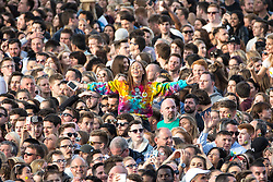 © Licensed to London News Pictures . 04/06/2017 . Manchester , UK . A woman in the audience sitting on someone's shoulders .  The One Love Manchester benefit concert for victims of the Manchester Arena terrorist attack , at the Emirates Old Trafford Cricket Stadium . Ariana Grande, Justin Bieber, Coldplay, Katy Perry, Miley Cyrus, Pharrell Williams, Usher, Take That, Robbie Williams, Black Eyed Peas and Niall Horan are amongst the performers. Photo credit : Joel Goodman/LNP