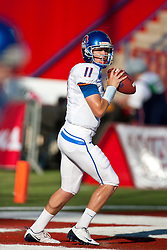 Sep. 18, 2009; Fresno, CA, USA; Boise State Broncos quarterback Kellen Moore (11) warms up before the game against the Fresno State Bulldogs at Bulldog Stadium.  Mandatory Credit: Jason O. Watson-US PRESSWIRE
