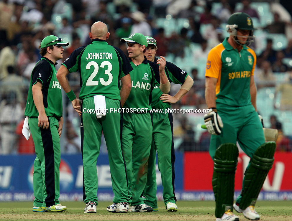 Ireland bowler Trent Johnston celebrates with team mates South African batsman Colin Ingram wicket during the ICC Cricket World Cup - 34th Match, Group B South Africa vs Ireland Played at Eden Gardens, Kolkata, 15 March 2011 - day/night