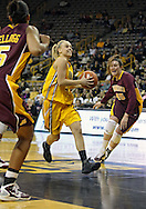 February 10 2011: Iowa Hawkeyes guard Jaime Printy (24) drives between Minnesota Golden Gophers forward Kionna Kellogg (5) and Minnesota Golden Gophers forward Jackie Voigt (45) during the first half of an NCAA women's college basketball game at Carver-Hawkeye Arena in Iowa City, Iowa on February 10, 2011. Iowa defeated Minnesota 64-62.