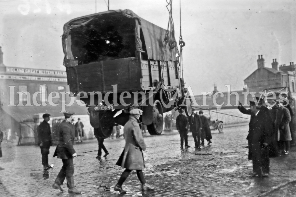 A Crossley Tender being loaded onto a transport vessel at North Wall, Dublin. Originally developed for the Royal Flying Corps, these, and other models based on the same chassis, had become standard British military vehicles during the First World War. Over 400 Crossley Tenders were transferred to the new Irish National Army in early 1922. (Part of the Independent Newspapers Ireland/NLI Collection)