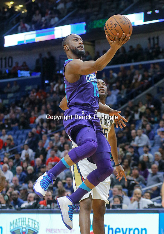 Mar 13, 2018; New Orleans, LA, USA; Charlotte Hornets guard Kemba Walker (15) shoots over New Orleans Pelicans forward E'Twaun Moore (55) during the first quarter of a game at the Smoothie King Center. Mandatory Credit: Derick E. Hingle-USA TODAY Sports