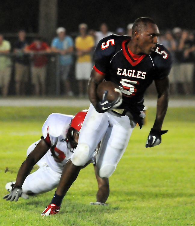 East Marion running back Xavier Grindle shakes off a West Marion defender as he heads down field. / Photo by Bryant Hawkins