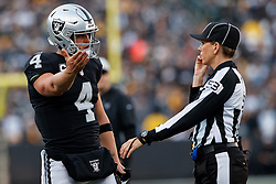 OAKLAND, CA - DECEMBER 09: Quarterback Derek Carr #4 of the Oakland Raiders argues a call with line judge Sarah Thomas #53 during the third quarter against the Pittsburgh Steelers at the Oakland Coliseum on December 9, 2018 in Oakland, California. The Oakland Raiders defeated the Pittsburgh Steelers 24-21. (Photo by Jason O. Watson/Getty Images) *** Local Caption *** Derek Carr; Sarah Thomas