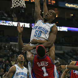 Jan 13, 2010; New Orleans, LA, USA; New Orleans Hornets center Emeka Okafor (50) grabs a rebound over Los Angeles Clippers guard Baron Davis (1) during the first half at the New Orleans Arena. Mandatory Credit: Derick E. Hingle-US PRESSWIRE