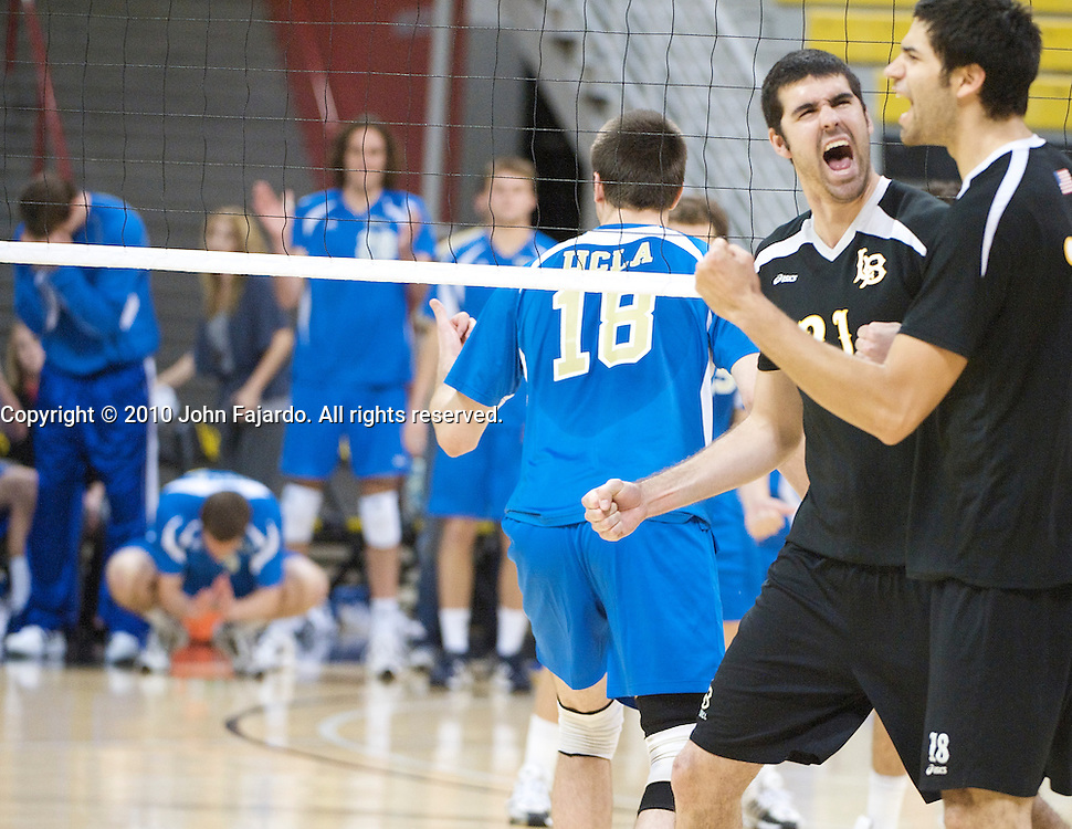 Dan Alexander(L) and Dean Bittner(R) celebrate the point in the Mountain Pacific Sports Federation match against UCLA at the Walter Pyramid, Long Beach Calif., Friday, April 9, 2010.