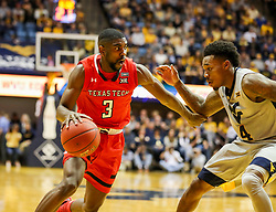 Feb 26, 2018; Morgantown, WV, USA; Texas Tech Red Raiders guard Josh Webster (3) drives to the basket while defended by West Virginia Mountaineers guard Daxter Miles Jr. (4) during the first half at WVU Coliseum. Mandatory Credit: Ben Queen-USA TODAY Sports