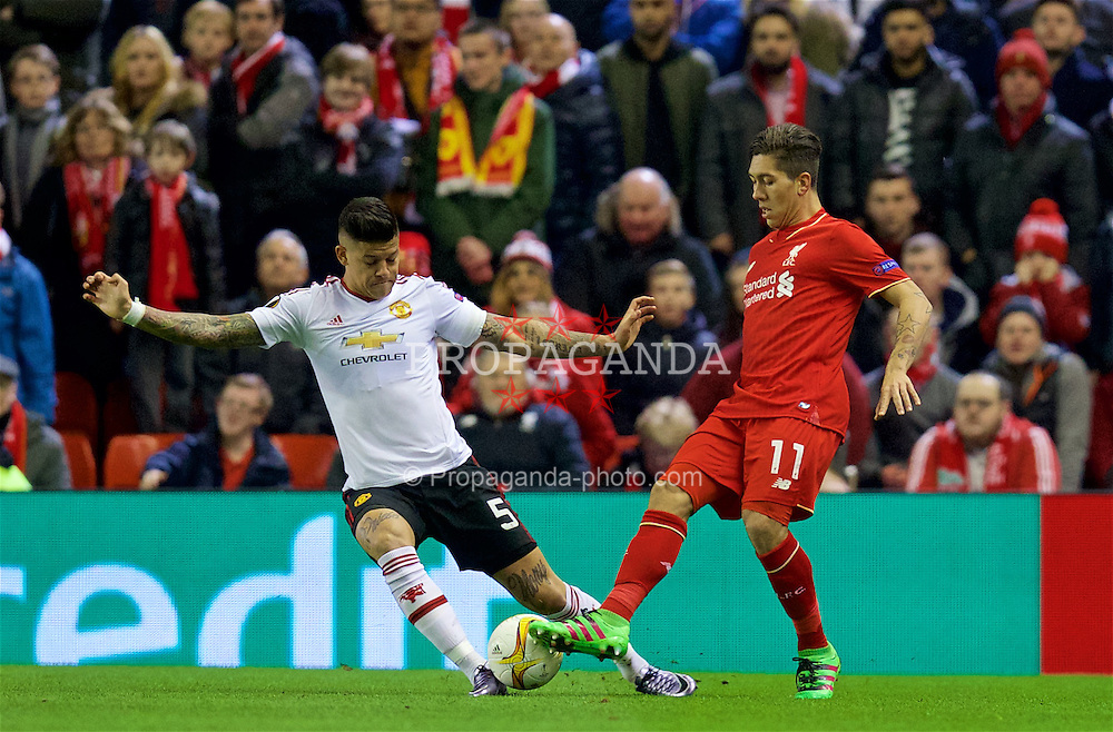 LIVERPOOL, ENGLAND - Thursday, March 10, 2016: Liverpool's Roberto Firmino in action against Manchester United's Marcos Rojo during the UEFA Europa League Round of 16 1st Leg match at Anfield. (Pic by David Rawcliffe/Propaganda)