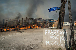 October 26, 2016 - Calais, France - Fires continue to rage in the Jungle camp as authorities demolish the site on October 26, 2016 in Calais, France. Overnight fires broke out in many parts of the camp destroying shacks and makeshift shops along the camps main street. Many migrants have left by coach to be reloctated at centres across France. (Credit Image: © Guillaume Pinon/NurPhoto via ZUMA Press)