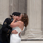 Courtney Legleu, left, and April Barosky kiss on the steps of The Supreme Court of the United States after being married with Twenty-four other gay couples the week before decisions are expected to be made on the Defense of Marriage Act (DOMA) and Proposition 8.  Legleu, recently joined the Army in August.  John Boal photography