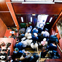 London, UK - 20 July 2012: London's Muslim faithful collect shoes and exit the East London Mosque during the first day of Ramadan.