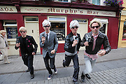 BECOMING ANDY WARHOL! FRAMING THE VISUAL ARTS PROGRAMME AT GALWAY ARTS FESTIVAL..A group of Andy Warhol look-a-likes were on High  St. Galway to launch the Visual Arts Programme of the Galway Arts Festival 2010, and to honour of the 'Father of Pop Art' who was the first artist to produce a creative collaborate with ABSOLUT in 1985.   Today's Warhol's will feature in a pop-art film by audio-visual artist Phil RetroSpector, a creative collaboration with ABSOLUT that expands the Visual Arts Programme this year from galleries to online spaces, a first time move for the Festival. Central to this year's programme is the introduction of a spectacular new temporary gallery, the Festival Fairgreen Gallery, just off Eyre Square, housed in a new building with an amazing glass façade and a beautiful flood of natural light.
