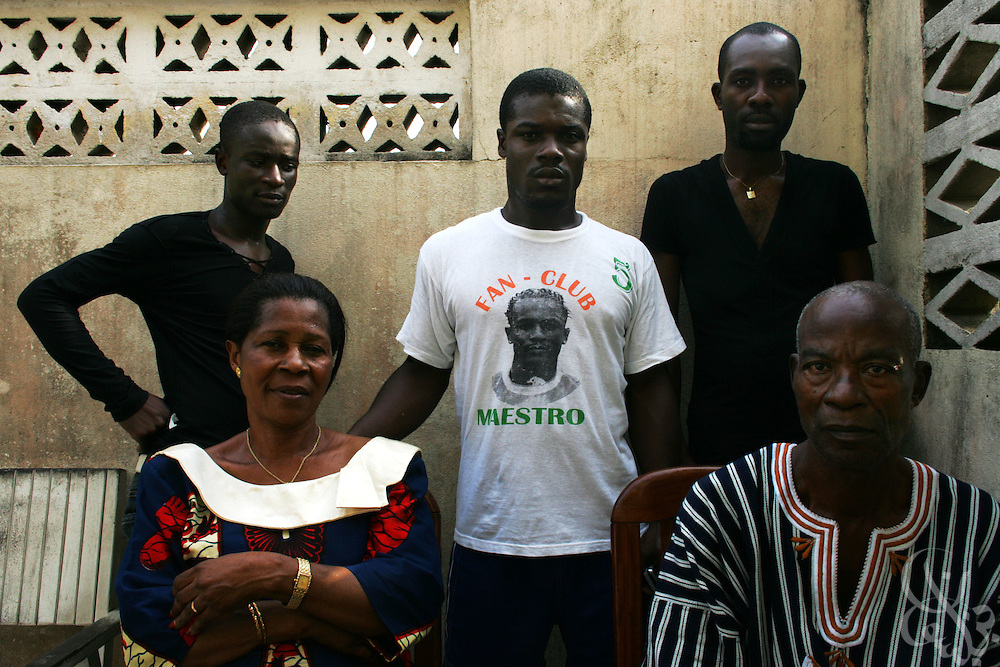 "The family of Côte d'Ivoire national football team member Didier ""Maestro"" Zokora (back row, brothers, left to right) Arnaud, Telesford, Guy (front row,parents, left to right) mother Alphonsine  and father Augustin Zokora pose for a picture at their home in the Yopoungon neighborhood of Abidjan, Côte d'Ivoire February 18, 2006. Alphonsine has founded a group called the ""mothers of the football playing elephants"" that meets monthly with the other mothers of national team members."