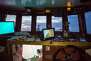The sonar and other marine equipment in the boats cabin used to avoid major objects on the sea bed while his nets are down trawling for fish. Luke is a Folkestone based fisherman out trawling solo for a regular 12 hour night shift on a fishing trip in his boat Valentine (FE20), Hythe Bay, the English Channel, United Kingdom. (photo by Andrew Aitchison / In pictures via Getty Images)