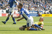 Photo: Steve Bond/Richard Lane Photography. Leicester City v Watford. Coca Cola Championship. 17/04/2010. Richie Wellens (L) is brought down by Jay DeMerit for a penalty