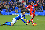 Tom Nicholls challenges Joe Rafferty during the EFL Sky Bet League 1 match between Peterborough United and Rochdale at London Road, Peterborough, England on 25 February 2017. Photo by Daniel Youngs.