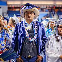052214       Cable Hoover<br /> <br /> WIndow Rock High School senior Julian Benally sports a cowboy hat with his graduation cap during the class of 2014 commencement ceremony at the Stronghold Event Center in Ft Defiance Thursday.