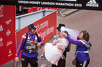 Paul Elliott and Laura Harvey celebrated their marriage after running the first half of the Virgin Money London Marathon.They went on to run the remainder of the race as husband and wife before they could enjoy their wedding reception, Sunday 26th April 2015.<br /> <br /> Dillon Bryden for Virgin Money London Marathon<br /> <br /> For more information please contact Penny Dain at pennyd@london-marathon.co.uk