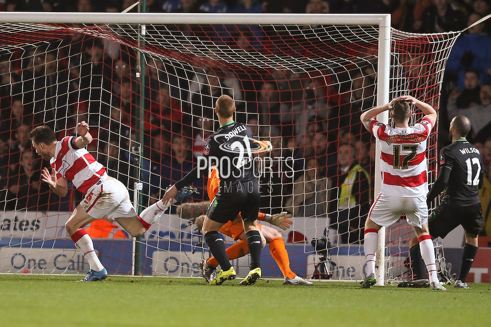 Disbelief from Doncaster Rovers defender Gary MacKenzie  as Doncaster Rovers defender Andrew Butler  misses from close in  during the The FA Cup third round match between Doncaster Rovers and Stoke City at the Keepmoat Stadium, Doncaster, England on 9 January 2016. Photo by Simon Davies.