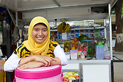 Nur Khayati, 24, with her fruit smoothie business.<br /> <br /> Nur was working in a restaurant when she downloaded the Usaha Wanita app. She wasn't planning to go into business then but the stories and advice about the need for women to be independent inspired her so much that she decided to invest her savings in setting up a juice stall.<br /> <br /> Her fruit is purchased daily and the juices are freshly prepared in front of the customer. <br /> <br /> Her business is just four months old but is already thriving. She has been able to give her parents 6 million rupiah, which they are investing in land to increase the size of their fruit farm. <br /> <br /> She is also opening a new booth in another part of town in two weeks time.