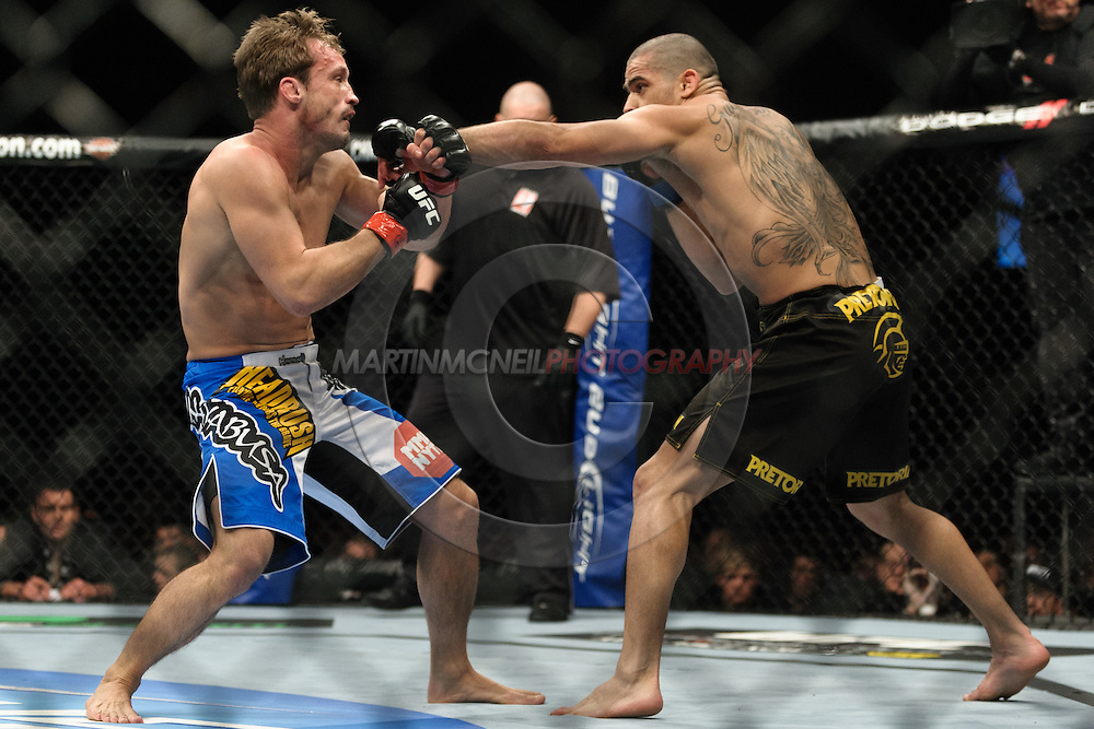 "BIRMINGHAM, ENGLAND, NOVEMBER 5, 2012: Brad Pickett (left) is stopped short by a left jab from Renan Barao during ""UFC 138: Munoz vs. Leben"" inside the National Indoor Arena in Birmingham, United Kingdom"