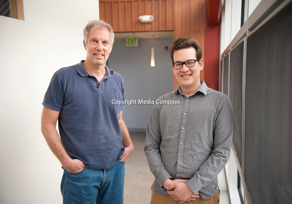 "Robert Pollin (left), Co-Director of the Political Economy Research Institute at University of Massachusetts in Amherst and Thomas Herndon (right) Graduate student at the University of Massachusetts in Amherst, pose for a portrait in the Gordon Hall building in the UMass campus in Amherst, Massachusetts on June 26, 2013. Herndon and Pollin wrote an article that critiques and finds flaws in Reingart's and Rogoff's ""Growth in a Time of Debt"" article."