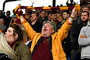 A Bradford City fan holds his scalf above his head during the EFL Sky Bet League 1 match between Portsmouth and Bradford City at Fratton Park, Portsmouth, England on 28 October 2017. Photo by Graham Hunt.
