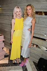 Left to right, PORTIA FREEMAN and PHOEBE COLLINGS JAMES at the opening of Roksanda - the new Mayfair Store for designer Roksanda Ilincic at 9 Mount Street, London on 10th June 2014.