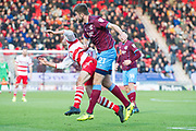 Doncaster Rovers Midfielder Matty Blair (17) is fouled by Scunthorpe United defender Cameron Burgess (21) during the The FA Cup match between Doncaster Rovers and Scunthorpe United at the Keepmoat Stadium, Doncaster, England on 3 December 2017. Photo by Craig Zadoroznyj.